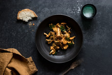 Bowl Of Chanterelle Mushrooms On Table
