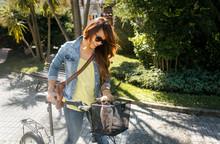 Asian Business Woman Walking On Bike