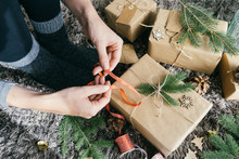 Closeup View Of Woman Hands Wrapping A Handmade Christmas Present
