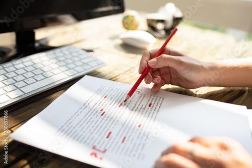 Fotografía  Person Marking Error With Red Marker