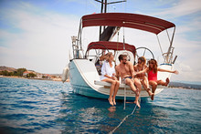 People Having Fun On A Sailboat At Summer Party.