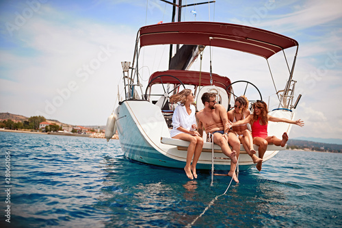 people having fun on a sailboat at summer party. Tablou Canvas