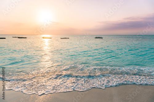 Montage in der Fensternische Sansibar NUNGWI, Zanzibar: colourful sunset at the beach. Turquoise sea, orange and purple sky.