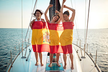 Woman On The Yacht In Spanish Flag Having Party At Vacation.
