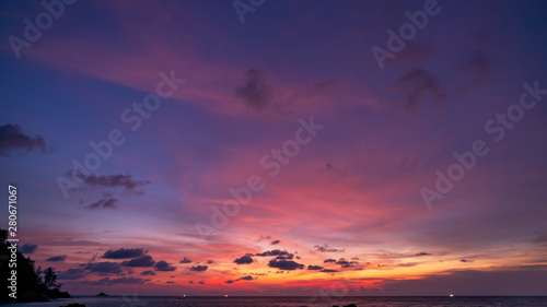 Foto auf Leinwand Aubergine lila Dramatic clouds Amazing colorful majestic sky over sea in evening time,Dark Blue​ Hour Silhouette mountain