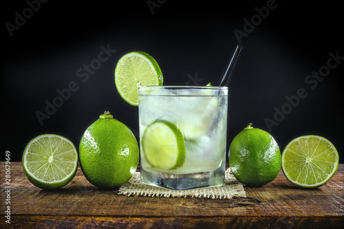 Obraz na plátně  Lemon Fruit Lime Caipirinha of Brazil on grey vintage, Brazilian traditional drink, isolated with space for text