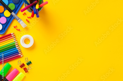 Fotografía School supplies on yellow background. Back to school concept..