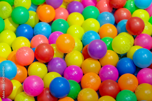 Poster Confiserie color plastic balls on children's playground