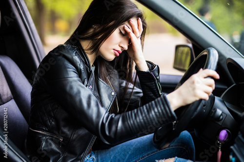 Business woman having headache taking off her glasses has to make a stop after driving car in traffic jam on rush hour Canvas Print