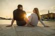 Leinwandbild Motiv Happy couple of lovers relaxing on the sea pier.