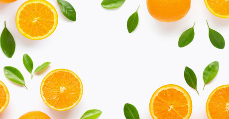 Frame made of fresh orange citrus fruit with leaves isolated on white background. Juicy and sweet.
