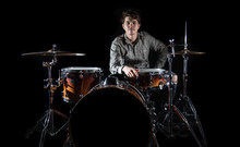 Professional Drummer Playing O...