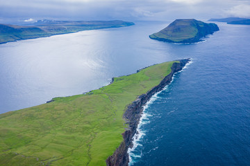 Aerial view of Koltur island in Faroe Islands, North Atlantic Ocean. Photo made by drone from above. Nordic Natural Landscape.