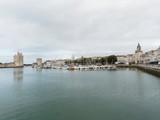 Fototapeta Paryż - La Rochelle. Porte de la grosse horloge le long du Vieux-Port