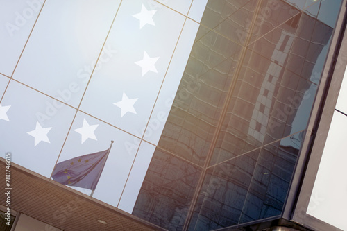 Modern office building with European Union on a background of th