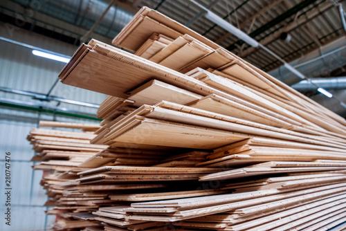 Fototapeta Stack of natural rough wooden boards. Wooden boards, lumber, industrial wood. obraz na płótnie