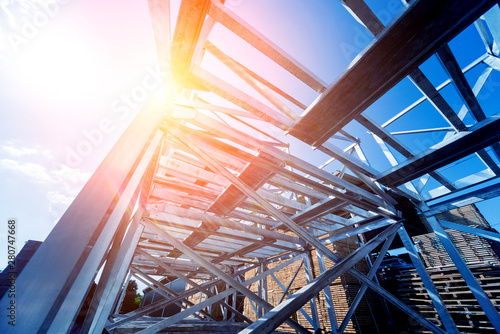 Structure of steel. Building construction on sky background. Canvas Print