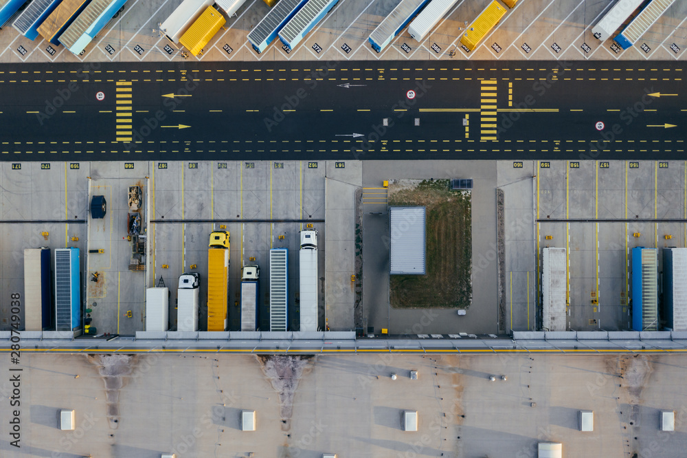 Fototapeta Aerial view of the distribution center, drone photography of the industrial logistic zone.