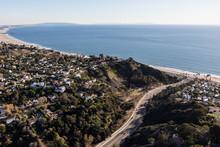 Aerial View Of Temescal Canyon Road, Pacific Palisades Homes And Santa Monica Bay In Los Angeles, California.