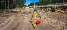 Panoramic View Of Surveyor Equipment (theodolite Or Total Positioning Station) On The Construction Site Of The Motorway Or Road