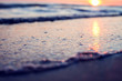 canvas print picture - A sunset on the beach. Sea and eveninig sky with clouds