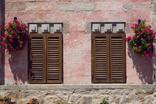 Two Closed Window Shutters On The Red Wall Of The House In Turkey