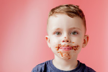 Little Boy Eating Chocolate. C...