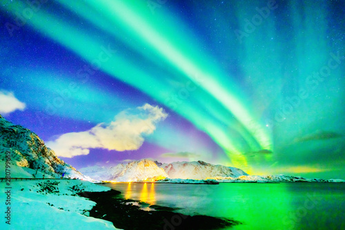Obraz Marvelous natural wonder - Northern Lights or Aurora Borealis. Colorful night scenery of Polar Lights over Norwegian Sea on Lofoten Islands Archipelago in Norway. Winter scene  of dramatic sky. - fototapety do salonu