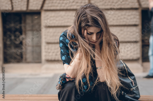 Crying out her soul, feeling alone and abandoned on a bench Wallpaper Mural