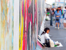 Tourists At The Berlin Wall. Berlin, Germany