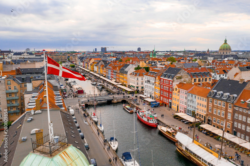 Beautiful view of the Danish Flag over Nyhavn district in Copenhagen.
