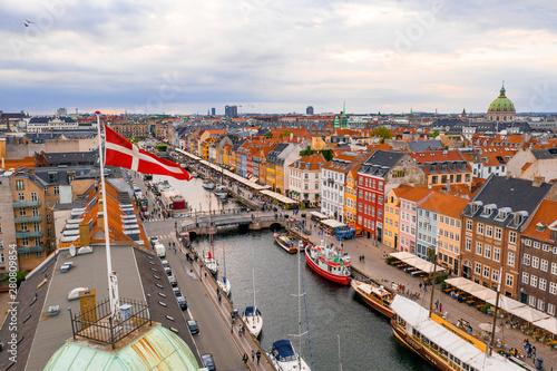 Beautiful view of the Danish Flag over Nyhavn district in Copenhagen.