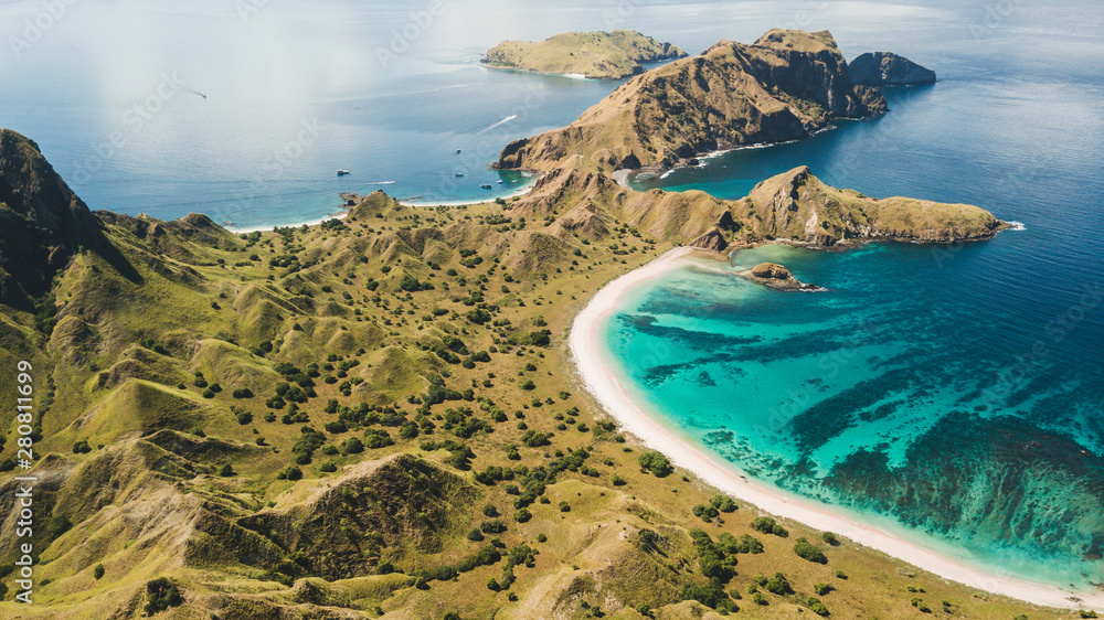 Fototapety, obrazy: Aerial panoramic view of Padar island in Komodo National Park, Indonesia. Drone shot, top view. Green hills and amazing beautiful coastline. Tropical background.