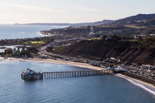 Aerial Of Historic Malibu Pier, Pacific Coast Highway And The Santa Monica Mountains Near Los Angeles In Southern California.