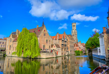 The Canals Of Bruges (Brugge), Belgium On A Sunny Day.