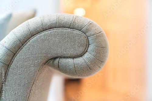 Fototapeta close up design part of sofa detail arm rest leg and upholsty fabric trim finishing furniture deisgn ideas concept obraz