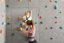 Instructor Helping Little Girl...