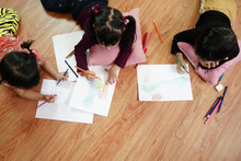 Children Drawing And Painting Color On The Paper With Happiness. Education And Little Artist Concept.