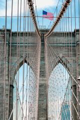 Fototapeta Industrialny Brooklyn Bridge. American Flag and Cloudy Sky Background, New York City
