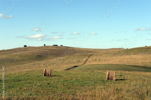 Rural Landscape With Harvested Hay Rolls In The Foothills Of