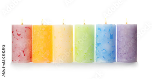 Alight color wax candles on white background Canvas Print