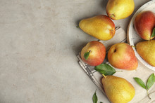 Ripe Juicy Pears On Grey Stone Table, Flat Lay. Space For Text
