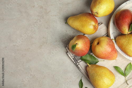 Ripe juicy pears on grey stone table, flat lay. Space for text Fotobehang