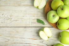 Flat Lay Composition Of Fresh Ripe Green Apples On White Wooden Table, Space For Text