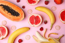 Flat Lay Composition With Condoms And Exotic Fruits On Pink Background. Erotic Concept