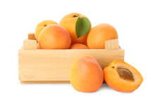 Wooden Crate Of Delicious Ripe Sweet Apricots Isolated On White