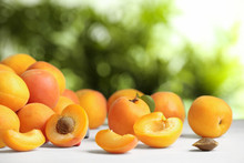 Delicious Ripe Sweet Apricots On White Table Against Blurred Background, Space For Text
