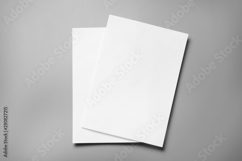Fotomural  Blank paper sheets for brochure on grey background, top view