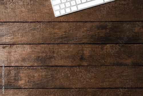 Obraz na plátně  Computer keyboard on wooden background with copyspace