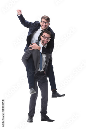 smiling businessman sitting on the back of his colleague